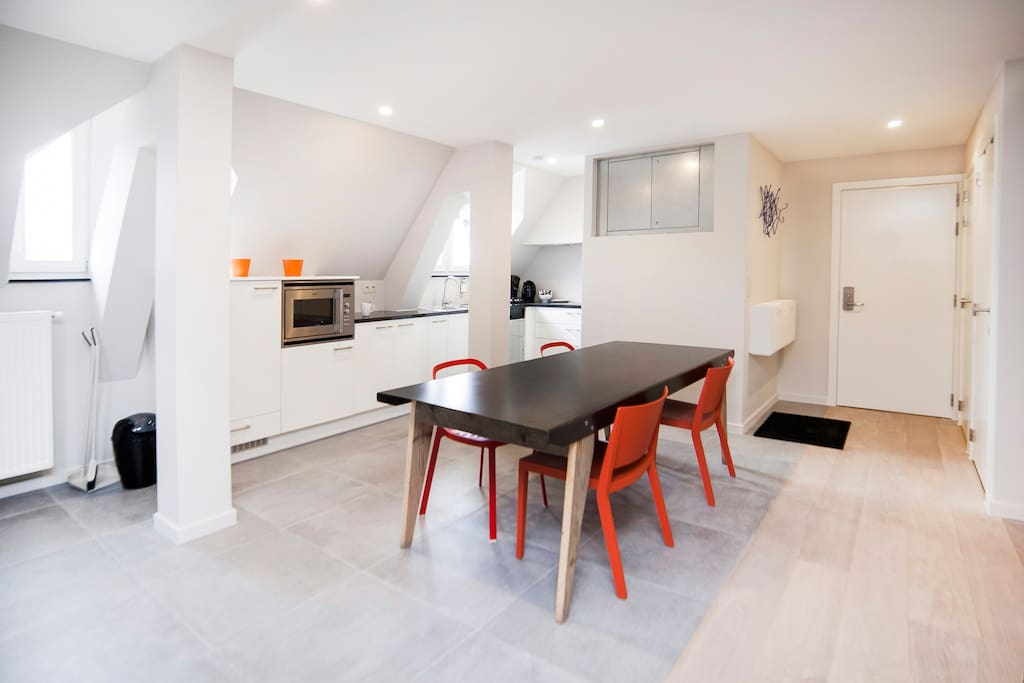 Fully equipped kitchen and dining table for easy self-catering.