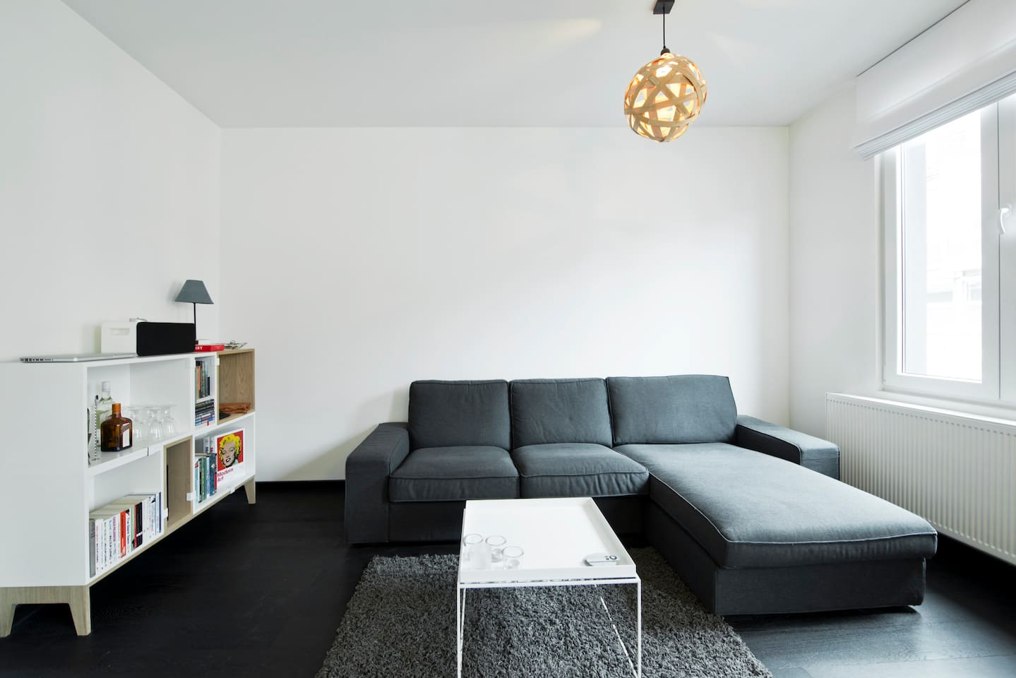 Comfortable sitting area with coffee table, a little bar and library. High quality speaker system with AUX-cable.