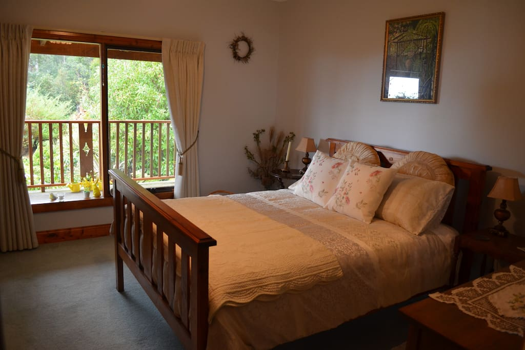 The second double room (can only be booked with the Queen room) offers a extra comfy double bed with quality, warm bedding, wooden underlay, bedside tables and lamps, space and plenty of storage.  This room is light filled with amazing views of the garden, valley and beyond. Styling is colonial, vintage country with touches of Tasmanian art and craft.