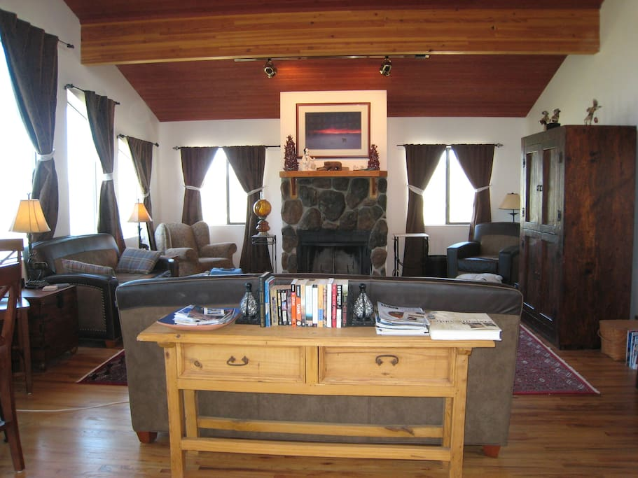 Great room with panoramic views and fireplace.
