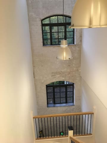 Warehouse conversion in popular village setting