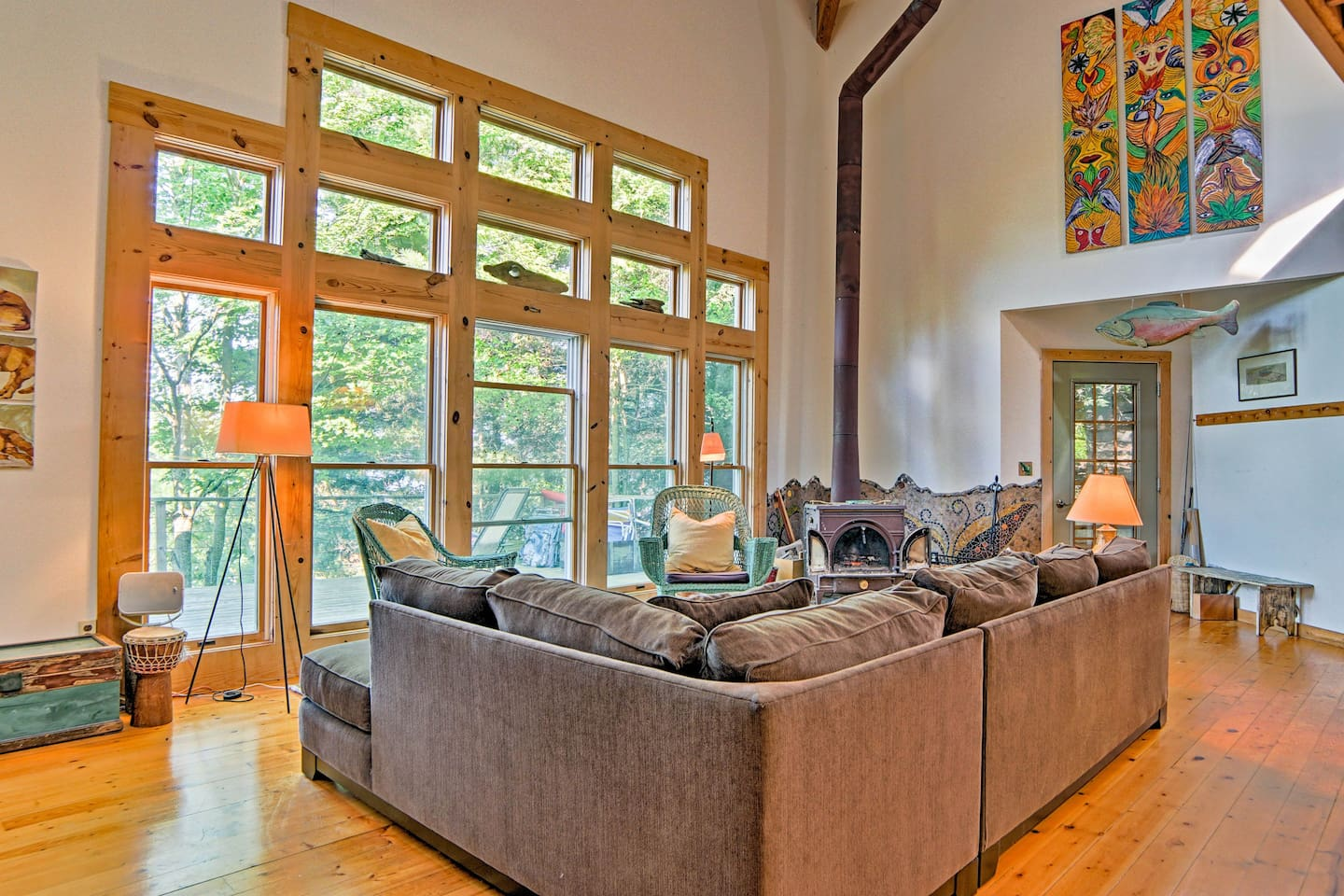 Towering windows pull the outdoors inside this incredible Pentwater home!