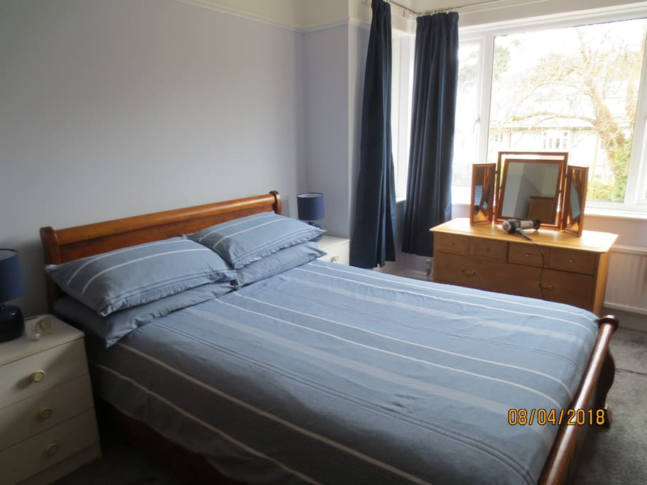 Bedroom 1. Double bed, dressing table, bedside cabinets and lamps.