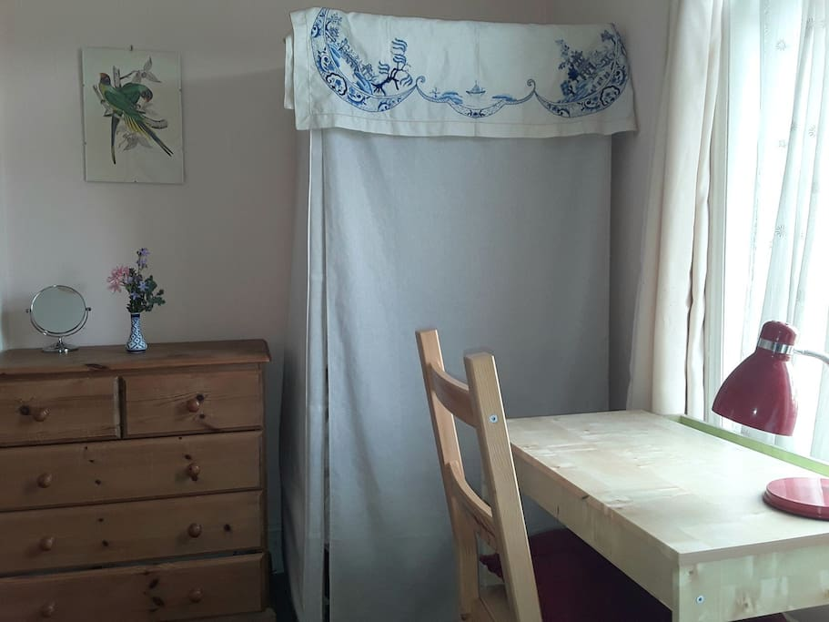 A nice light desk space and wardrobe for hanging clothes