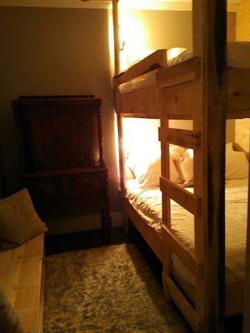 new queen over queen built in bunk beds, cozy set up, lights, rough wood work