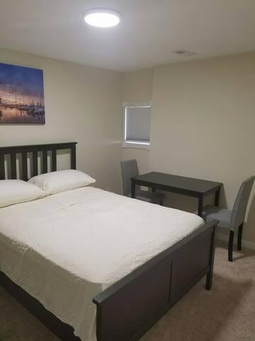 Basement room between airport & downtown!