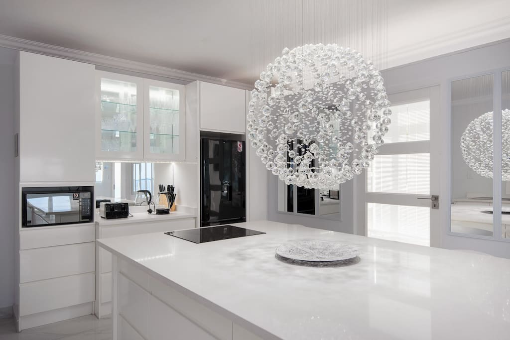 Fully equipped open plan kitchen with modern features