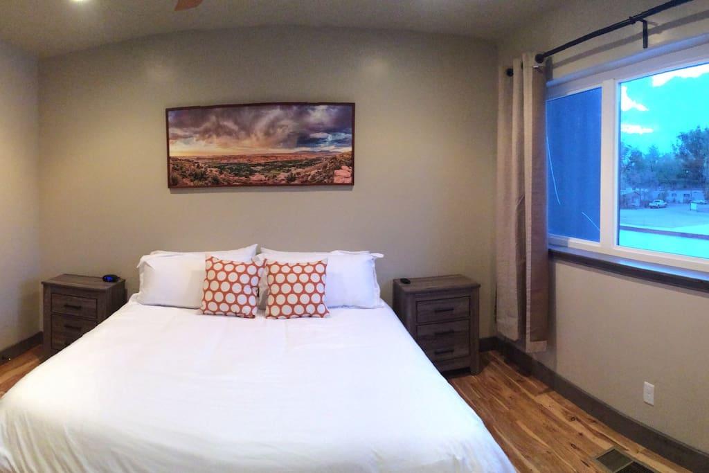Master Bedroom Suite. King Bed, Flat Screen TV, Walk in Closet, Hardwood Floors.