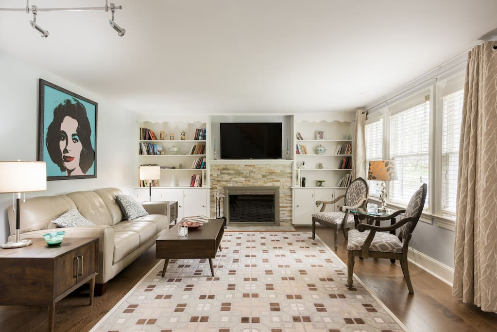 With hardwood floors throughout, new leather and custom furniture, decorative fireplace...perfect for entertaining.