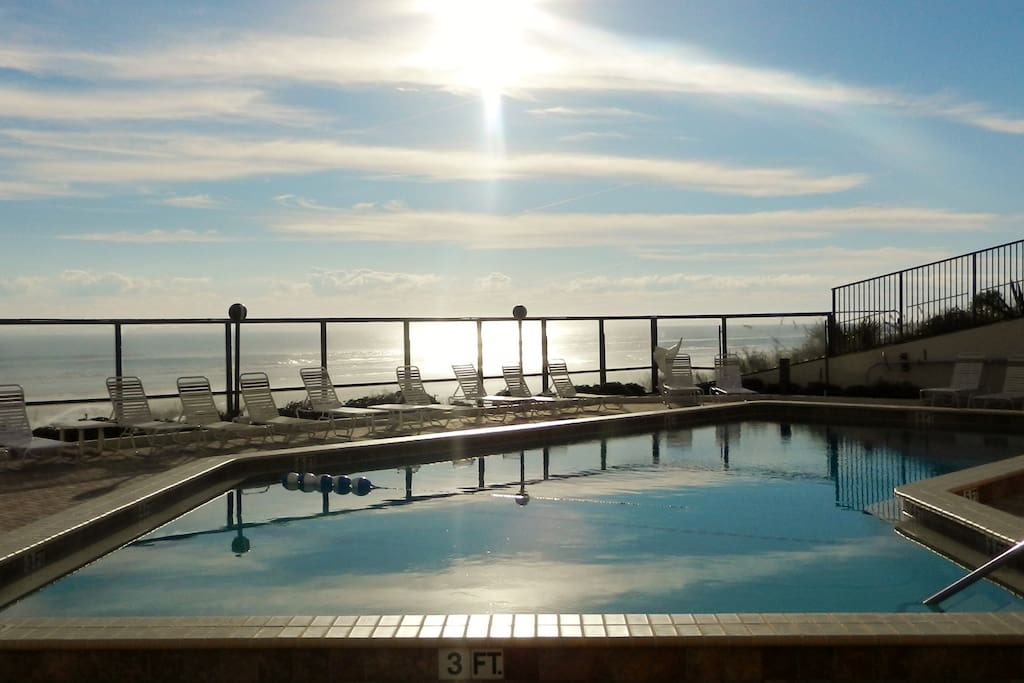 Watch the sunrise over the pool or the beach!