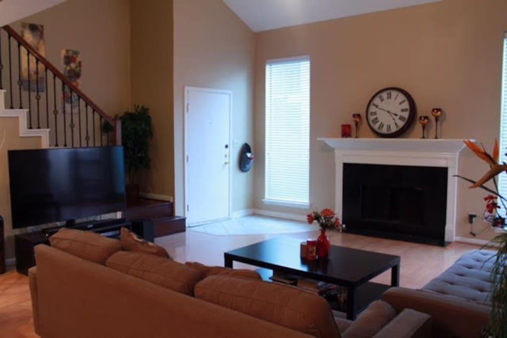 Big screen TV, fireplace