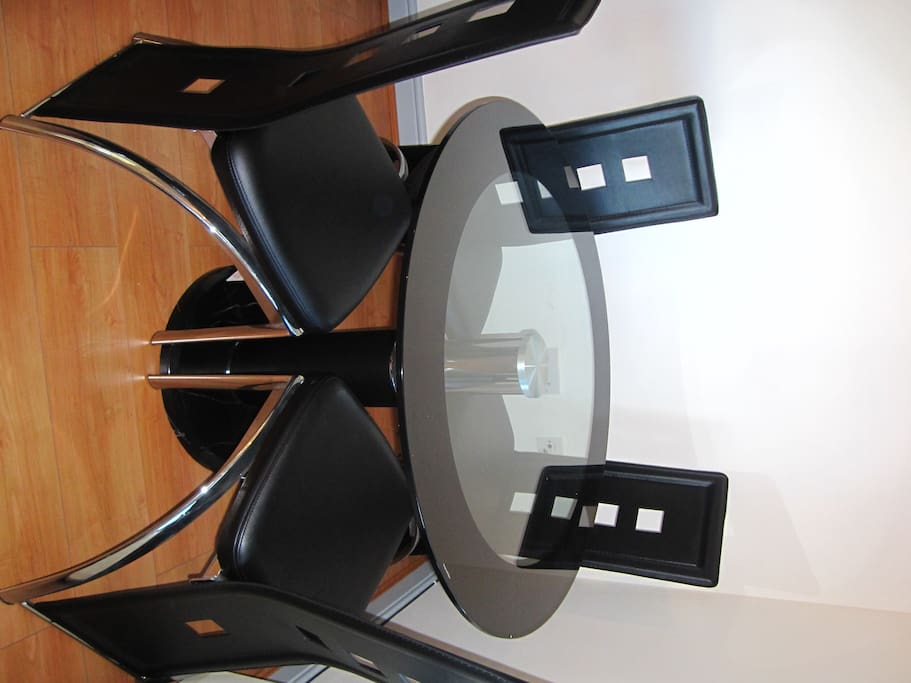 Glass dining table and chairs perfect to entertain friends and family