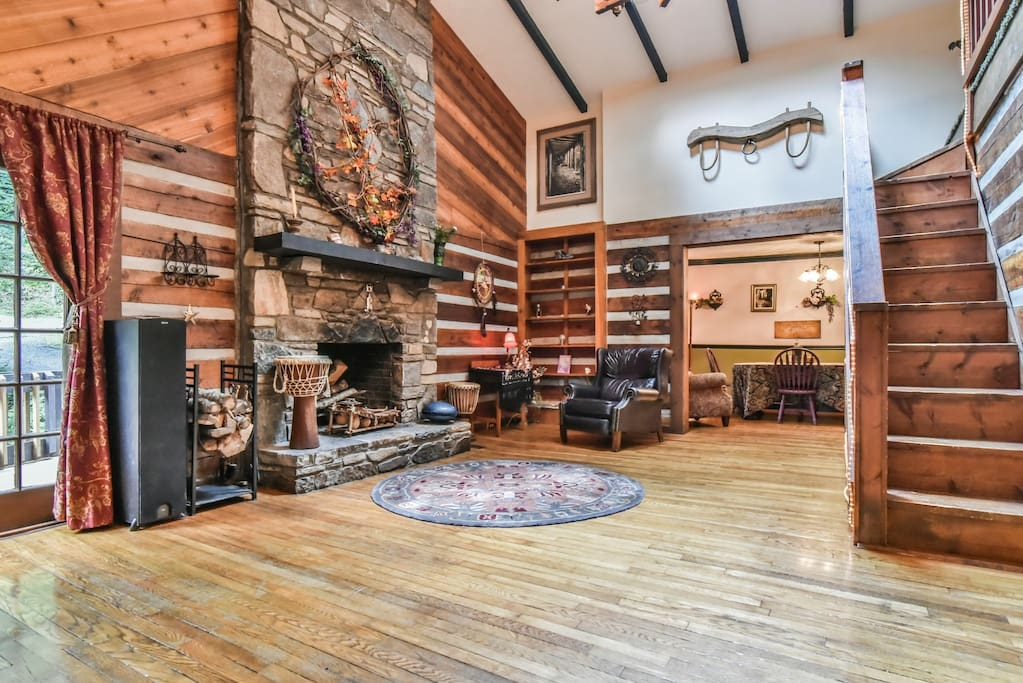 Living room with working stone fireplace, vaulted ceiling and sky lights.