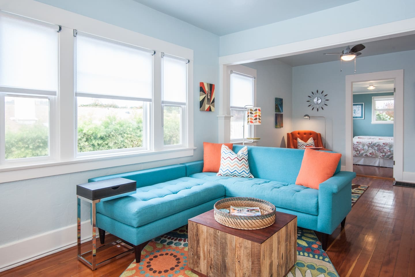 Living room offers garden and ocean views, seating for 6, and space for working remotely.