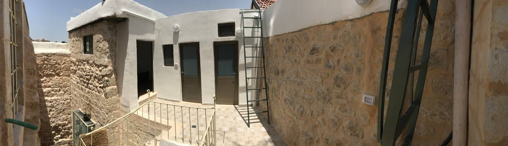 Doors to the private kitchen and bathroom, as well as the ladder to the rooftop seating area