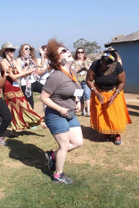 Visitors trying a Zulu Dance