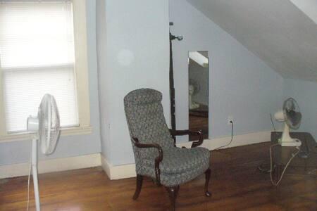 Large room, wood floor, 2 windows