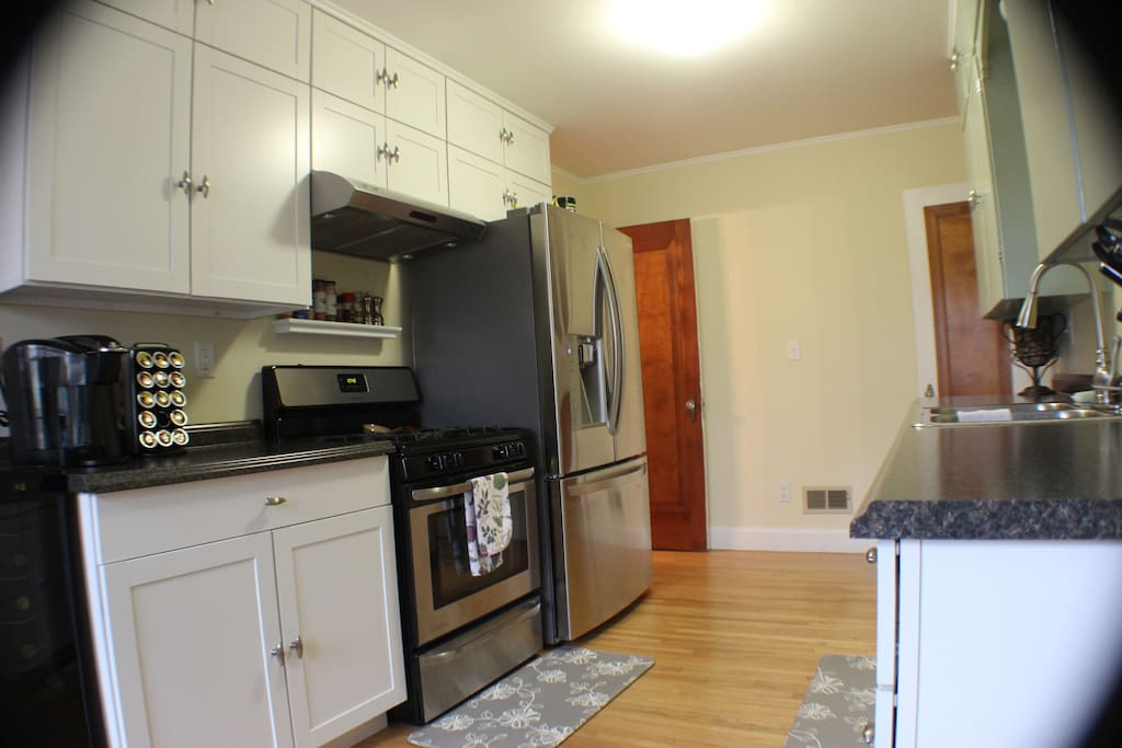 Keurig and gas stove, stainless steel fridge and dishwasher.
