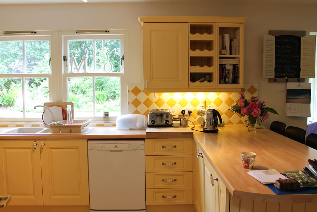 Large dining kitchen with garden room off.  Views to the  private garden.