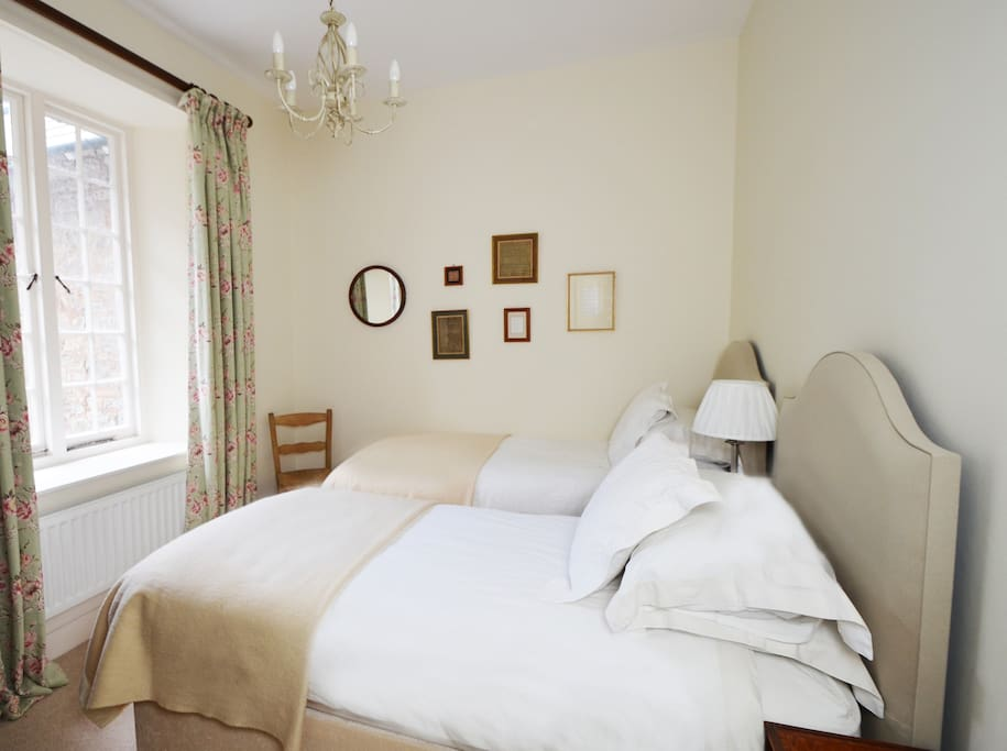 Comfortable twin bedroom with private bathroom/loo and seperate loo.  Beds can be made into a large double bed