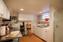 Here's another view of the kitchenette so you can see the relationship of the shower to the sink, wash machine and dryer.