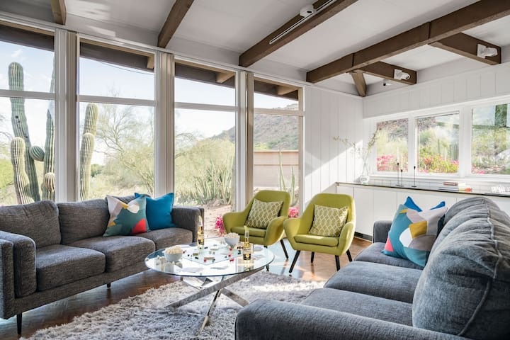 Floor to ceiling windows brighten this colorful and eclectic mid-century modern home.