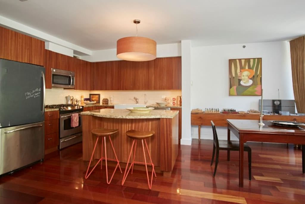 This open plan kitchen is fully equipped, including microwave and dishwasher, double sink. It is very much a cook's kitchen. It is open to the dining room and living room so it is a lot of fun to cook and entertain at the same time, all the while enjoying