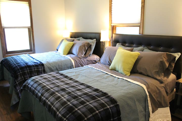 Four bed pillows provided on each bed, a well as an extra blanket for those chilly nights.