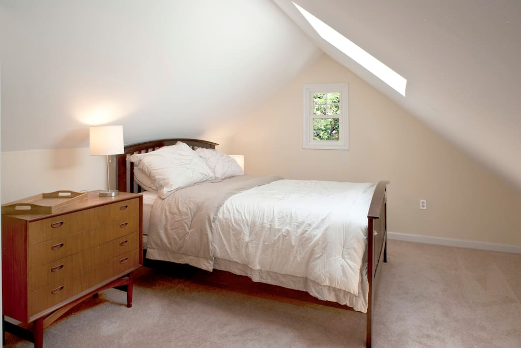 Comfortable Stearns & Foster double mattress with star gazing view through the skylight