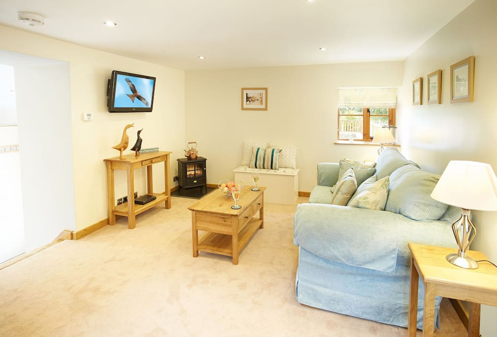 Ground floor: Sitting room with electric flame effect wood burning stove