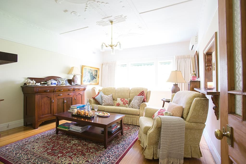 Sitting room with comfy couches and garden views