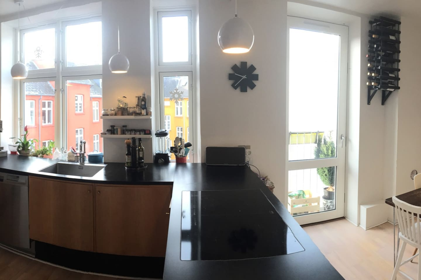Big and bright kitchen with dining table and a cosy balcony with sunshine all day