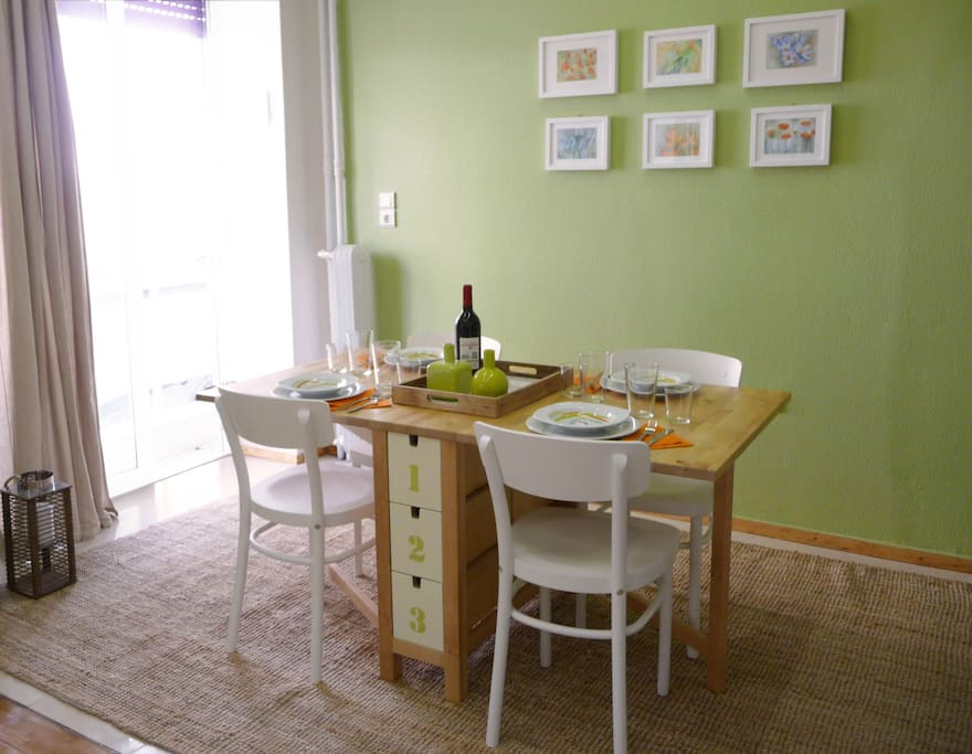 Entering straight into the open-plan living area, you'll come first to a neat table for four