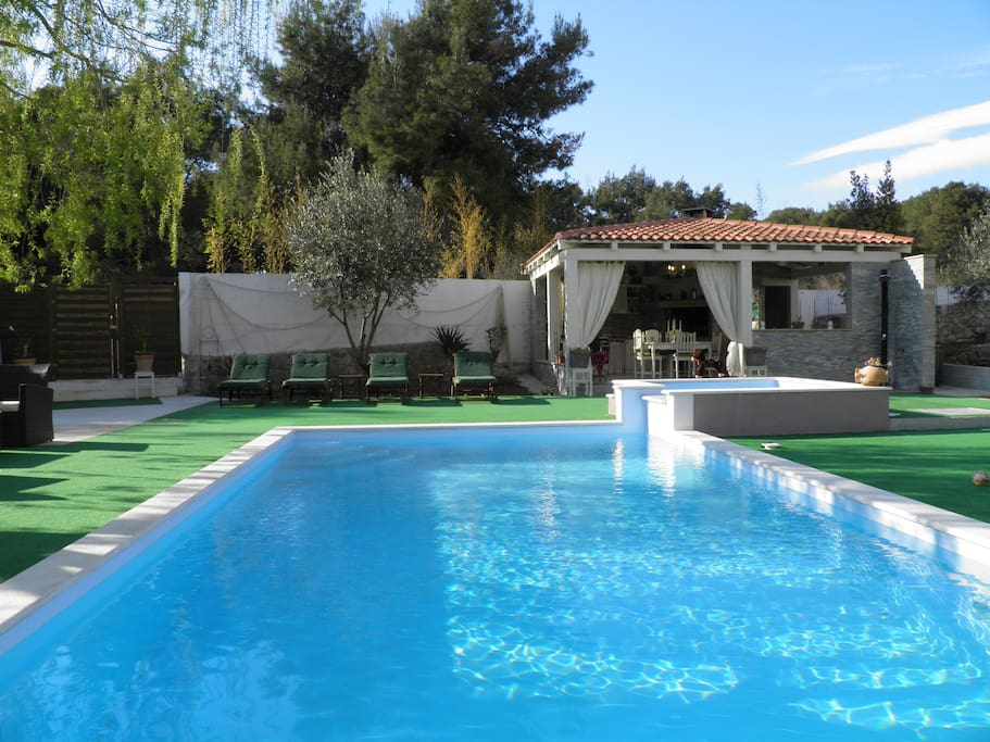 swimming pool with summer house