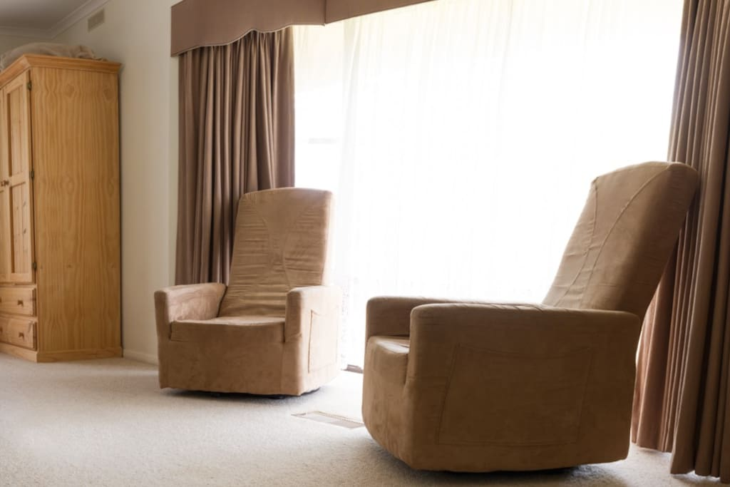 2 comfortable lounge chairs and wardrobe