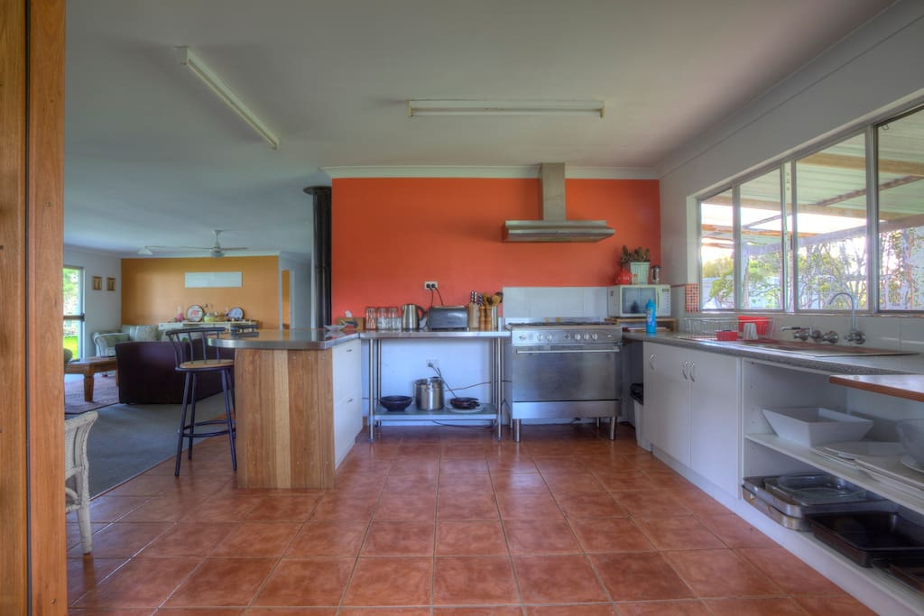 Fully equipped kitchen with stainless steel appliances and a gas stove.