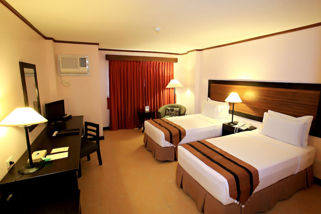 Spacious and furnished Deluxe rooms with free wi-fi. You can choose to have one King size bed or Twin beds.