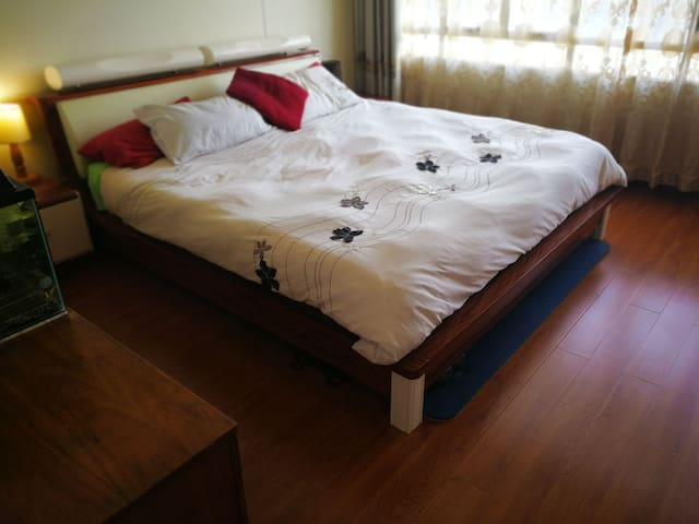 Hospitality grade king size bed set with incredible views of the city and lake.
