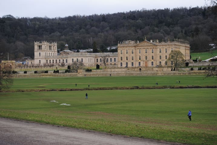 A February view across the park to the magnificent and recently renovated Chatsworth House. Many people out walking and exploring.
