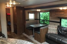 Dining, couch and back bunk area