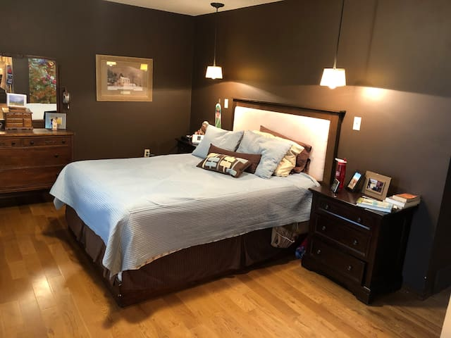 master bedroom is a queen mattress.  the mattress is brand new in 2021.  the master bedroom has a adjacent toilet, sink and shower and 3 large windows
