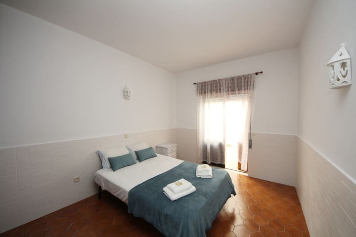 Double Bedroom with big wardrobe and inner patio.