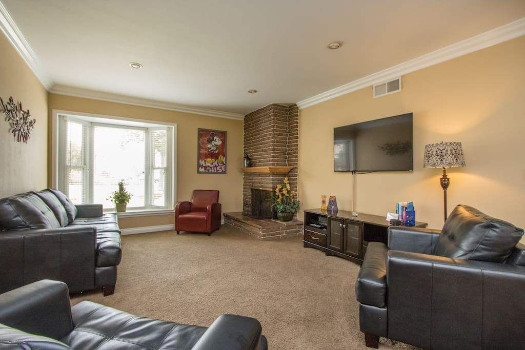 Our large family room is bright and comfortable, with a 55 inch smart TV and Blu-ray.