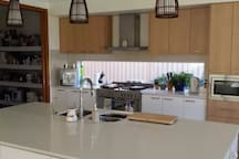 CHEF'S KITCHEN & PANTRY. SPACE PROVIDED IN PANTRY FOR GUESTS IF REQUIRED
