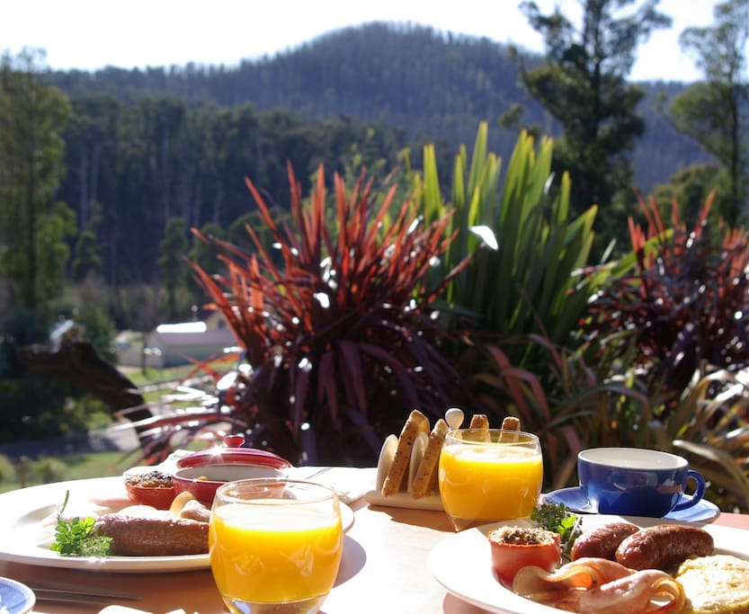 Enjoy breakfast on your private veranda overlooking the mountains.