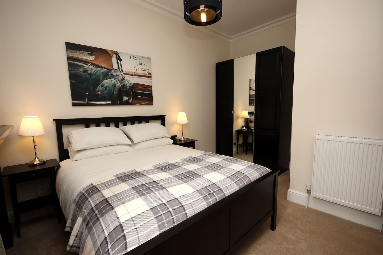 Kingsized bed provides luxury sleeping.