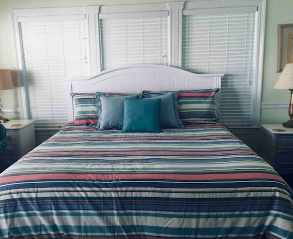 Master bedroom with new king bed and mattress set. Imagine an ocean front bedroom and huge balcony with panoramic  view of the Emerald water and sugar white sand.