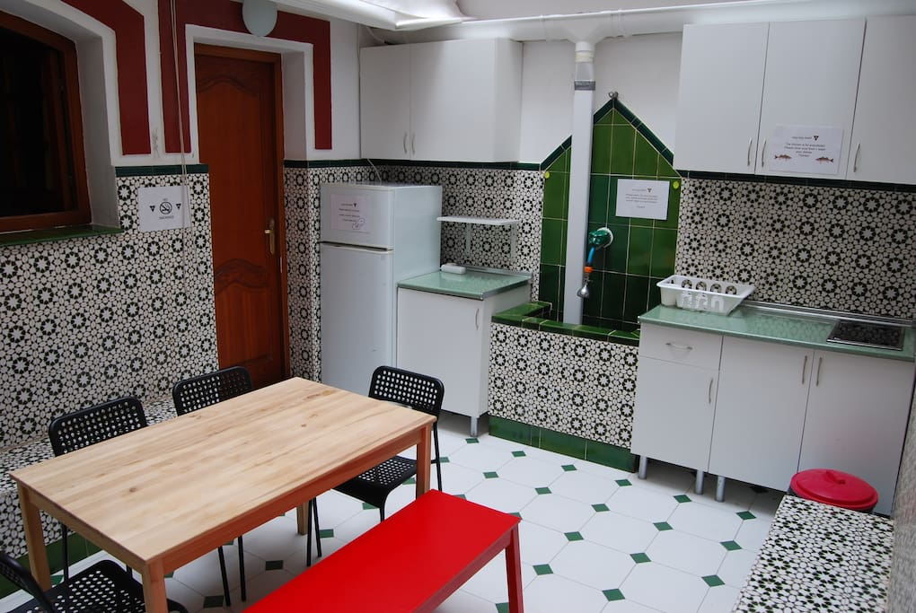 shared kitchen with fridge, cooker, microwave and kettle
