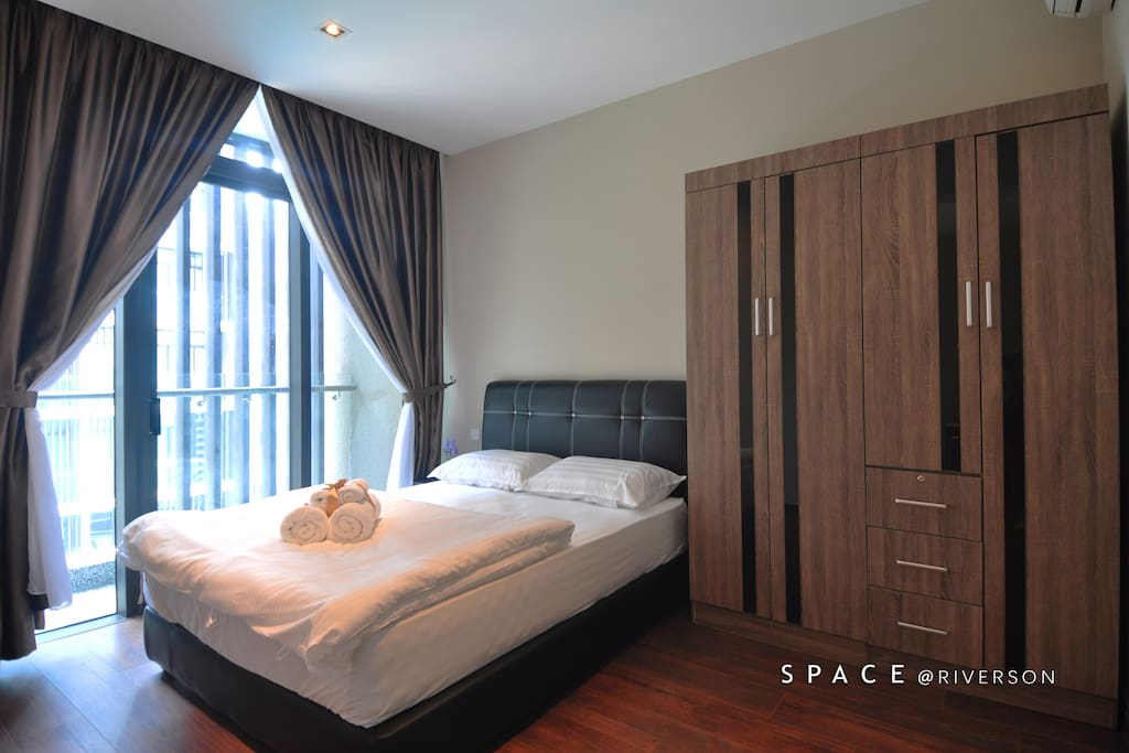 Queen bed room with ample wardrobe space. Balcony with swimming pool view.
