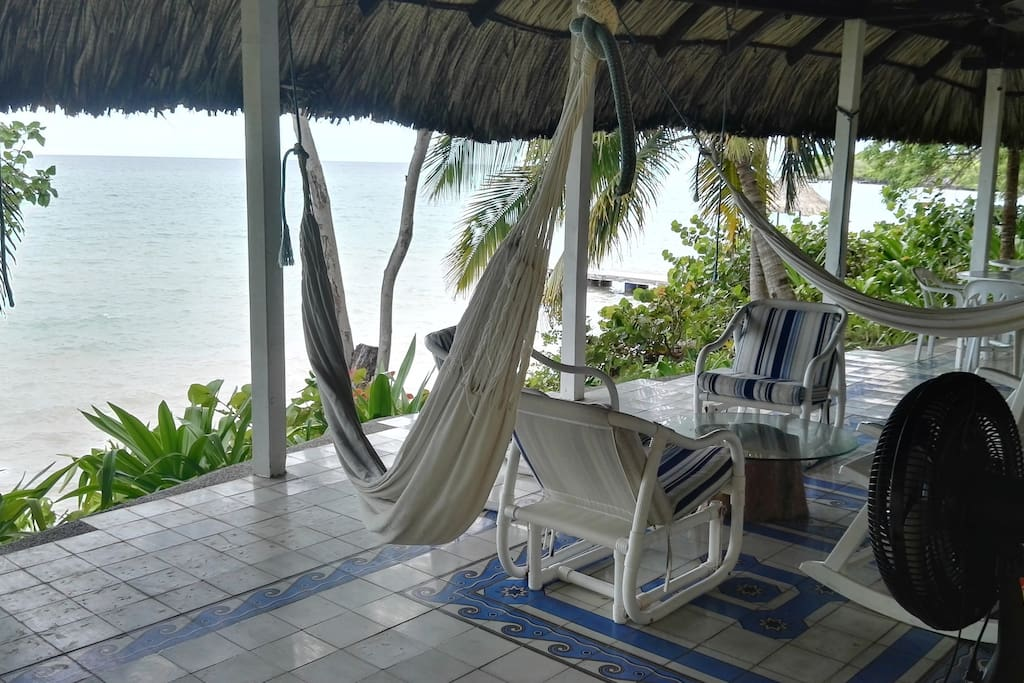 House terrace infront of the sea, very comfortable, with a magic view and surrounded by nature.